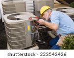 repairman works on air... | Shutterstock . vector #223543426