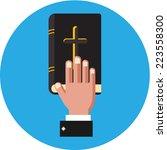 vector hand on the bible  | Shutterstock .eps vector #223558300