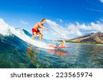 father and son surfing together.... | Shutterstock . vector #223565974