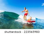 father and son surfing together ... | Shutterstock . vector #223565983