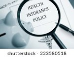 magnifying glass over health... | Shutterstock . vector #223580518