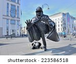 Small photo of BRUSSELS, BELGIUM-MARCH 08, 2014: Sculpture De Vaartkapoen created in 1985 illustrating cartoon serial about Quick and Flupke