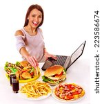 woman eating fast food at work. ... | Shutterstock . vector #223586674