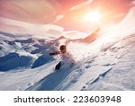 young man skiing in powder snow | Shutterstock . vector #223603948