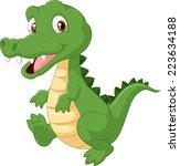 happy cartoon crocodile | Shutterstock .eps vector #223634188