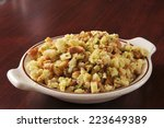 a bowl of cornbread stuffing in ... | Shutterstock . vector #223649389