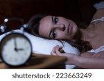 woman lying in bed suffering... | Shutterstock . vector #223663249
