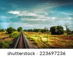 railway track crossing rural... | Shutterstock . vector #223697236