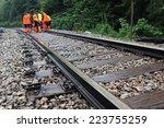 workers in orange  raincoats... | Shutterstock . vector #223755259