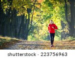 young man running in the park | Shutterstock . vector #223756963
