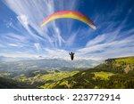 Paraglider Flying Over...