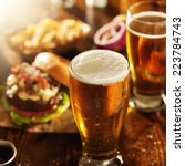 beer and burgers on wooden table | Shutterstock . vector #223784743