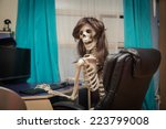 Funny Smiling Skeleton Sitting...
