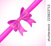 big shiny pink bow and ribbon... | Shutterstock .eps vector #223823713