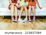 three young girls sitting on... | Shutterstock . vector #223837384
