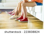 three young girls sitting on... | Shutterstock . vector #223838824