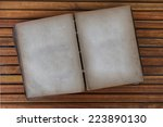 open old book with text on... | Shutterstock . vector #223890130