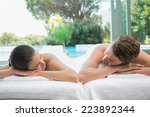 portrait of young couple lying... | Shutterstock . vector #223892344