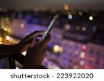 woman using her mobile phone ...   Shutterstock . vector #223922020