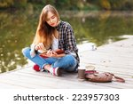 young beautiful girl sitting on ... | Shutterstock . vector #223957303