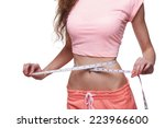 woman measuring her slim body... | Shutterstock . vector #223966600