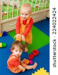 baby plays in a nursery | Shutterstock . vector #224022424