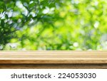 empty wooden deck table with... | Shutterstock . vector #224053030