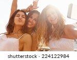 Three Teenage Girls Dancing An...