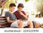 teenage boys on park bench... | Shutterstock . vector #224122990