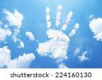 Palm  Hand Cloud Shape On Sky.