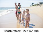 happy family in swimsuit having ... | Shutterstock . vector #224164408
