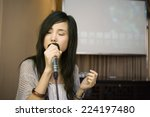 Young Woman Singing Karaoke ...