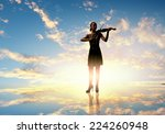 silhouette of woman playing... | Shutterstock . vector #224260948