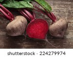 Small photo of Beetroot with herbage on wooden background