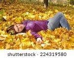 beautiful woman lying among... | Shutterstock . vector #224319580