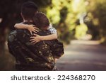 Woman And Soldier In A Militar...