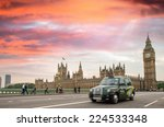 Blurred Black Taxi Cab Moving...