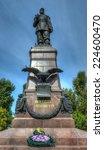 "Small photo of IRKUTSK, RUSSIA - SEPTEMBER 4, 2013: Monument to Emperor Alexander III in Irkutsk Russia. It was opened in 1908. Inscription mean ""To Emperor Alexander III"""