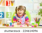 smiling kid playing with... | Shutterstock . vector #224614096