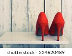 Stock photo red women shoes on wooden background 224620489