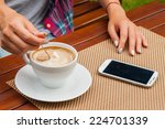 women hands with mobile phone... | Shutterstock . vector #224701339