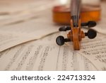 old violin lying on the sheet... | Shutterstock . vector #224713324