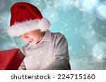 festive boy opening gift... | Shutterstock . vector #224715160