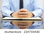 businessman sitting at his...   Shutterstock . vector #224733430