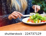blonde woman eating green... | Shutterstock . vector #224737129