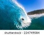 surfing inside hollow blue wave ...   Shutterstock . vector #224749084