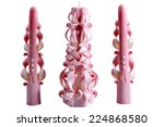 Candles for Christmas pink, three pieces, handmade carved, isolated on white background. - stock photo