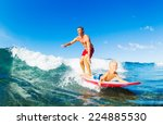 father and son surfing together | Shutterstock . vector #224885530