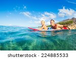 father and son surfing together | Shutterstock . vector #224885533