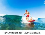 father and son surfing together | Shutterstock . vector #224885536
